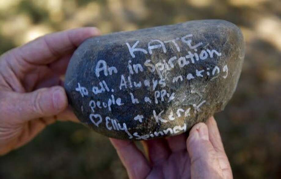 James Steinle the father of  Kate Steinle who was shot and killed on Pier 14 in July, in San Francisco, Calif., holds one of a stones with remarks from people who attended his daughter's memorial service. The hundreds of stones were given back to the parents who said they will make a rock garden containing the special messages at their home. Photo: Michael Macor, The Chronicle