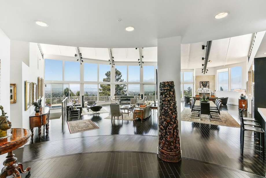 The open interior boasts floor-to-ceiling windows and generous scale. Photo: Open Homes Photography
