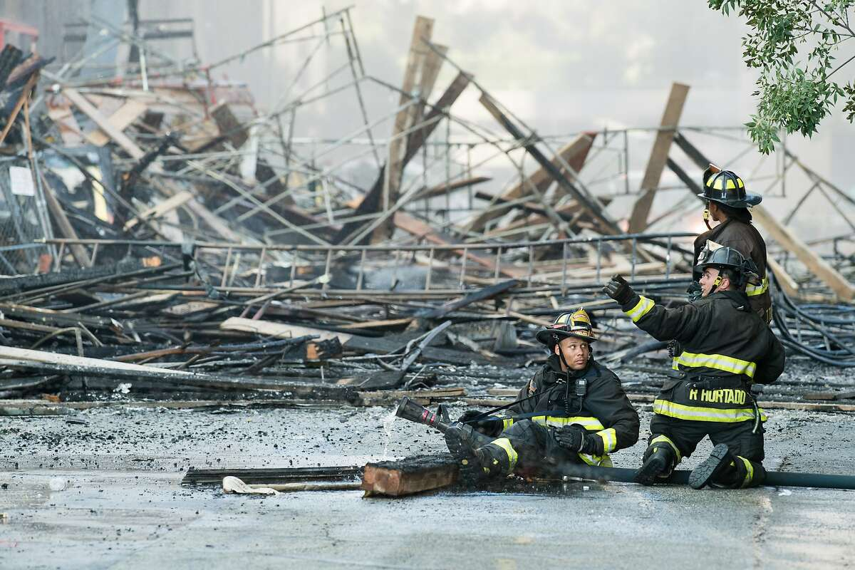Firefighters battle a building fire at Valdez and 23rd Streets in Oakland, Calif., on Friday, July 7, 2017.