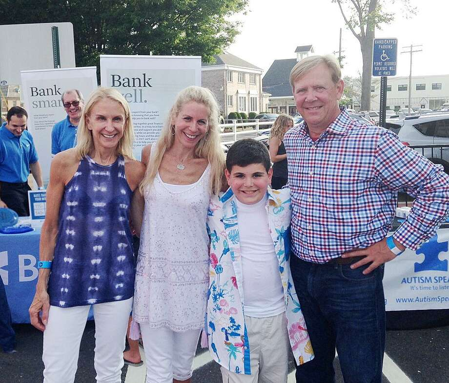 Bankwell Director of Marketing Diane Knetzger, left, attends the Fairfield Theatre Company/Autism Speaks kickoff event with Allison Ziering Walmark, an FTC board member, Ethan Walmark, a Westport 11-year-old and keyboardist in the band Clueless, and Joe Rog, director of development at FTC. Photo: Contributed Photo / Fairfield Citizen