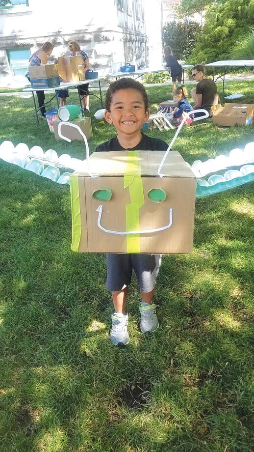 A youngster shows off his cardboard bug during a recent Arts in the Park session at Edwardsville City Park. Photo: For The Intelligencer