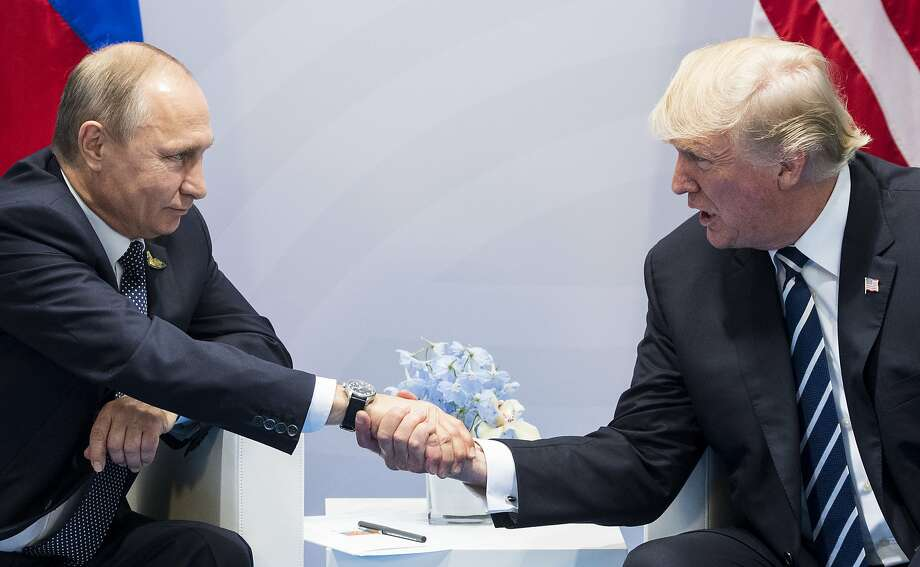 Russian leader Vladimir Putin and President Trump also agreed to impose a new cease-fire in Syria. Photo: Marcellus Stein, Associated Press