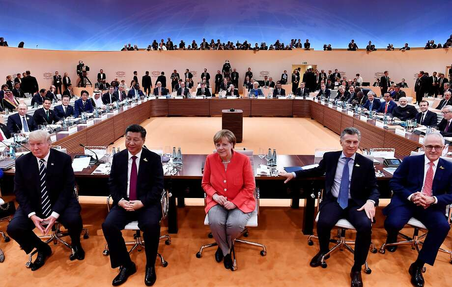 From left: President Donald Trump, Chinese President Xi Jinping, German Chancellor Angela Merkel, Argentinia's President Mauricio Macri and Australia's Prime Minister Malcolm Turnbull at the start of the first working session of the G-20 summit in Hamburg, Germany, July 7, 2017. (John Macdougall/Pool via The New York Times) -- FOR EDITORIAL USE ONLY. -- Photo: JOHN MACDOUGALL, NYT