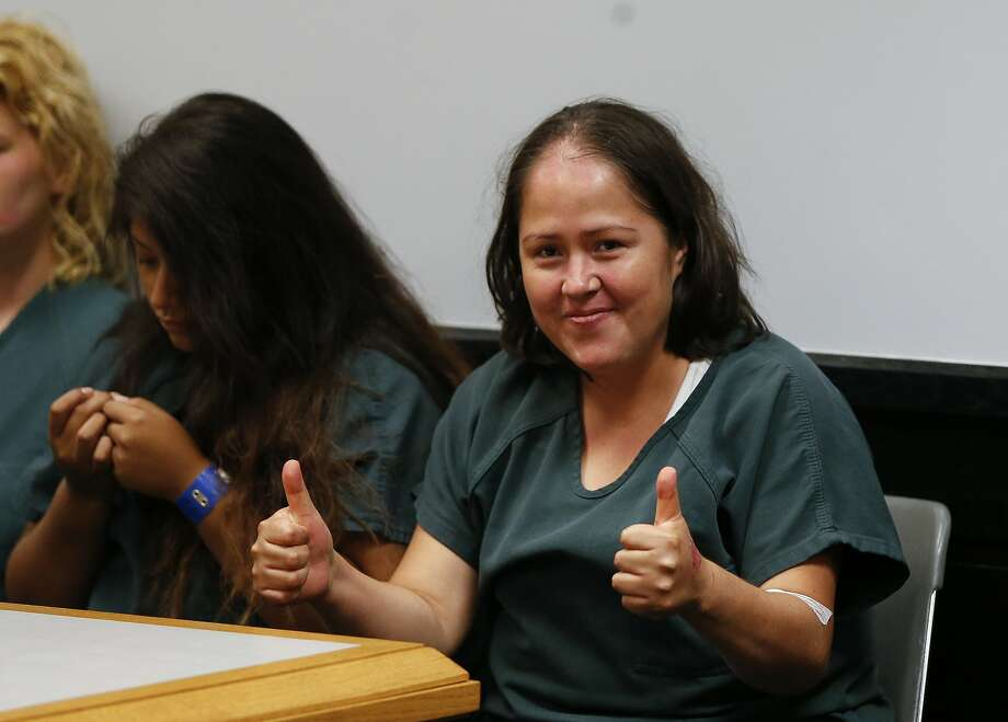 Isabel Martinez smiles at news cameras during a court appearance in Lawrenceville, Ga. She is charged with murder. Photo: John Bazemore, Associated Press