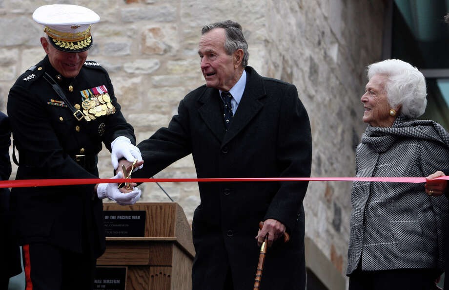 Former President George H.W. Bush (center) and General James T. Conway, Commandant of the U.S. Marine Corps, along with former first lady Barbara Bush (right) gets ready to cut the ribbon at the grand opening celebration of the George H.W. Bush Gallery at the National Museum of the Pacific War in Fredericksburg. The opening celebration was held in conjunction with Pearl Harbor Day ceremonies. JOHN DAVENPORT/jdavenport@express-news.net Photo: JOHN DAVENPORT, STAFF / jdavenport@express-news.net