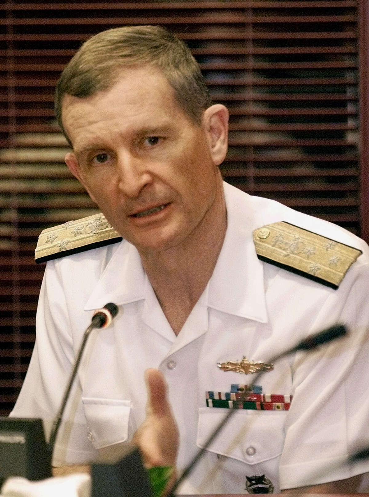 **FILE** This Nov. 27, 2001 file photo shows retired admiral and former commander of the U.S. Pacific Command Dennis Blair speaking during a news conference in Jakarta, Indonesia. President-elect Barack Obama's decision to fill the nation's top intelligence jobs with two men short on direct experience in intelligence gathering surprised the spy community and signaled the Democrat's intention for a clean break from Bush administration policies. (AP Photo/Dita Alangkara, file)
