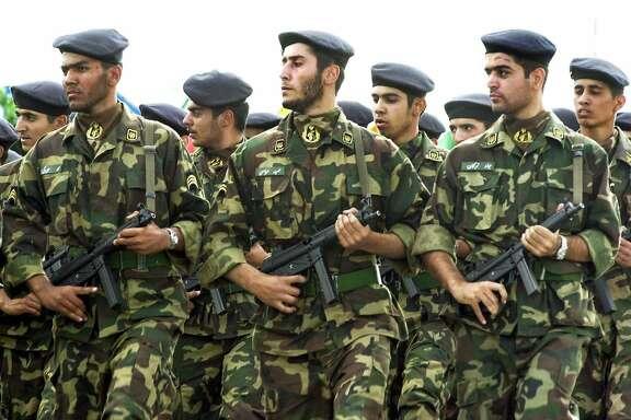 Soldiers of Iran's Revolution Guards at am event �commemoratingthe Iran-Iraq War