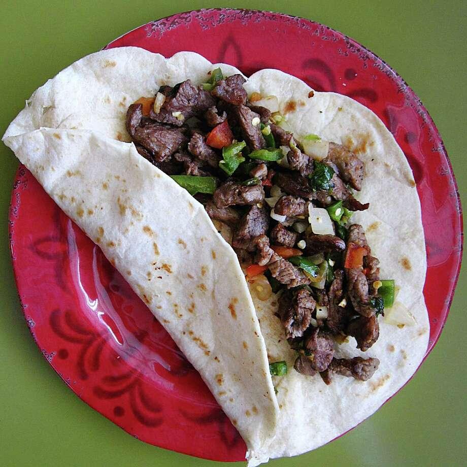 Steak a la mexicana taco on a handmade flour tortilla from Alondras De Jalisco. Photo: Mike Sutter /San Antonio Express-News