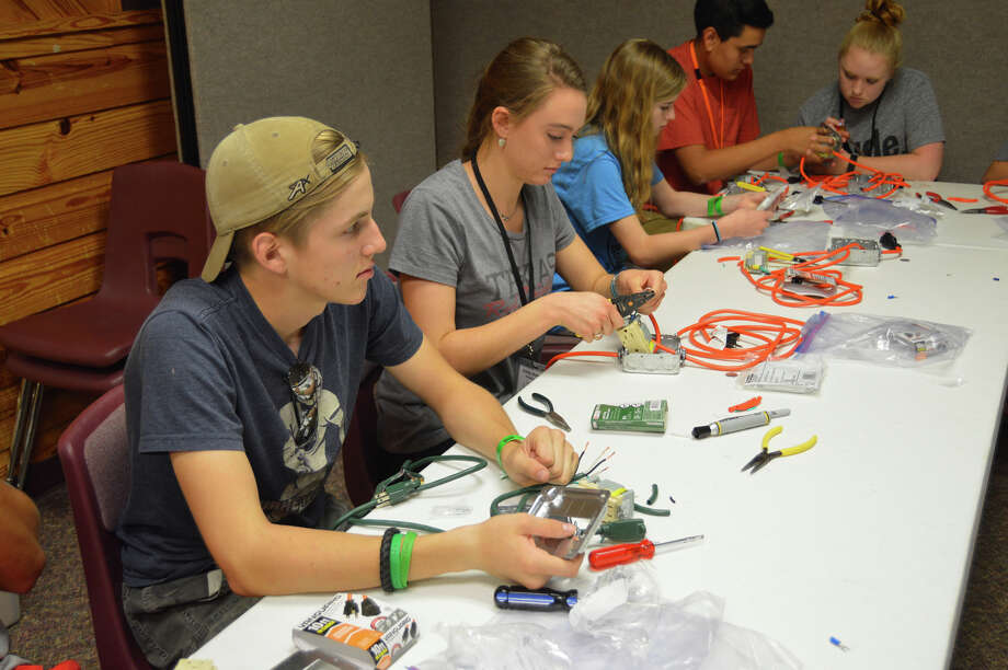 4-Hers from the Panhandle and South Plains learn about wiring during the Xcel Energy/4-H Power Camp.