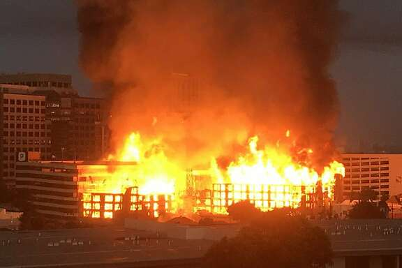 A fire on Friday, July 7, 2017, ripped through a building under construction at Valdez and 23rd streets in downtown Oakland, causing evacuations of neighboring buildings.