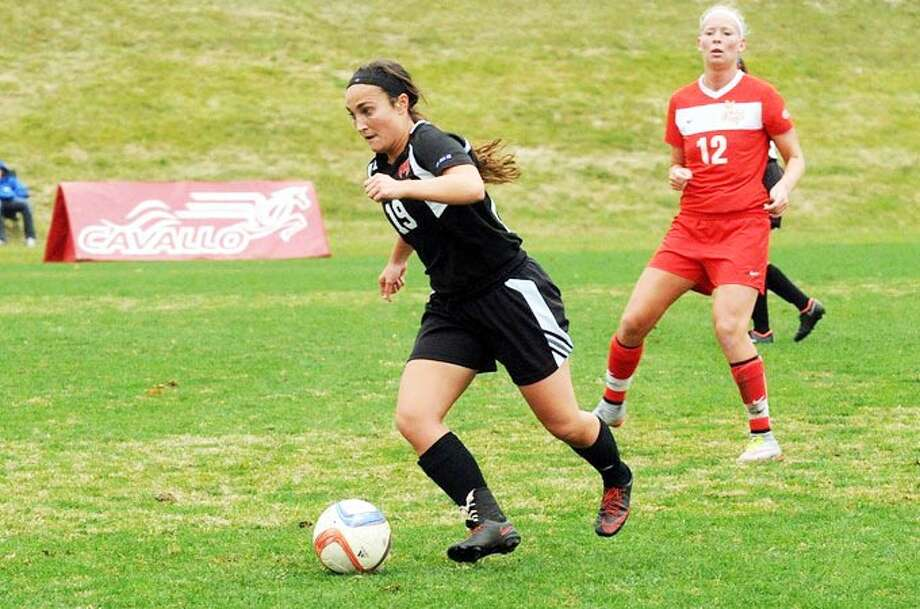 Rachel Wiesehan, left, dribbles the ball up the field in a regular season game during the 2016 fall season for Maryville University.
