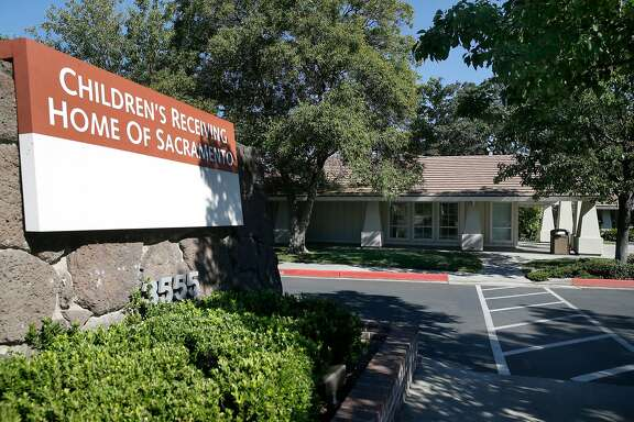 """The main entrance of the Children's Receiving Home of Sacramento is seen on Auburn Boulevard in Sacramento, Calif. on Friday, July 7, 2017. For the past year and a half, in violation of state health and safety laws, hundreds of children awaiting foster care placement in Sacramento County have had to sleep in the lobby of the county child welfare system's central intake office here, or in an adjacent pair of """"Comfort Rooms,"""" often on cots, fold-up mats and air mattresses."""