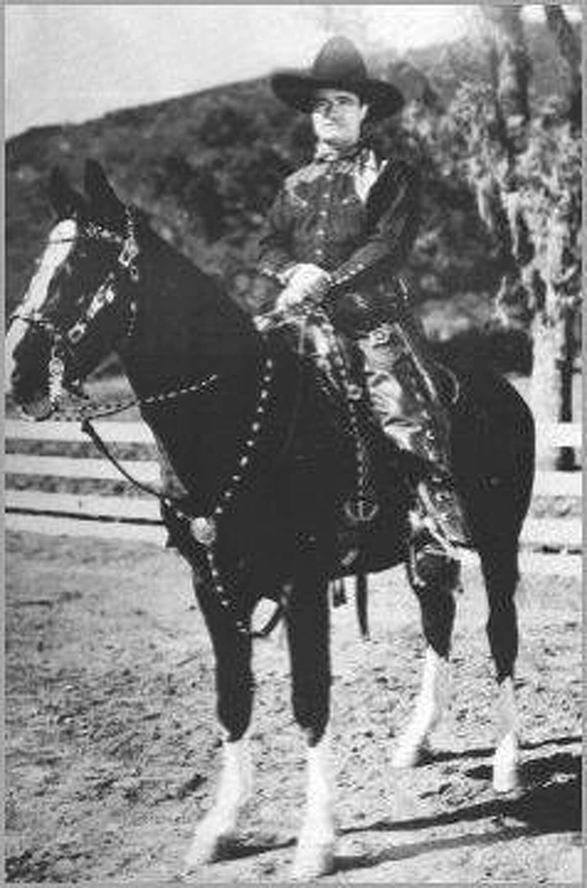 TOM MIX Above, Tom Mix during the early 1930s at Universal and atop Tony Jr. (has four white socks). HOUCHRON CAPTION (02/05/2002): Tom Mix atop Tony Jr. on the Old Corral Web site.