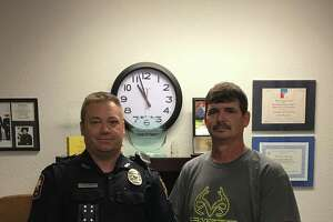 Silsbee Police officer Chris Hartman, left, and Billy Gordon, of Fred.