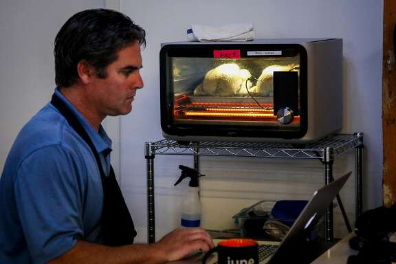 Henry Portner, culinary associate, works on programing cook cycles for chicken in the June offices in San Francisco on Thursday, July 6, 207. The June Intelligent Oven detects what food is placed into it and how long it should be cooked.