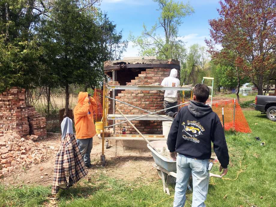 Team Sunrise Real Estate owners, Danny DeWolf and Georgiann Chinoski, recently preserved the site of the 1872 Port Crescent sawmill chimney in the state park. Photo: Submitted To The Tribune