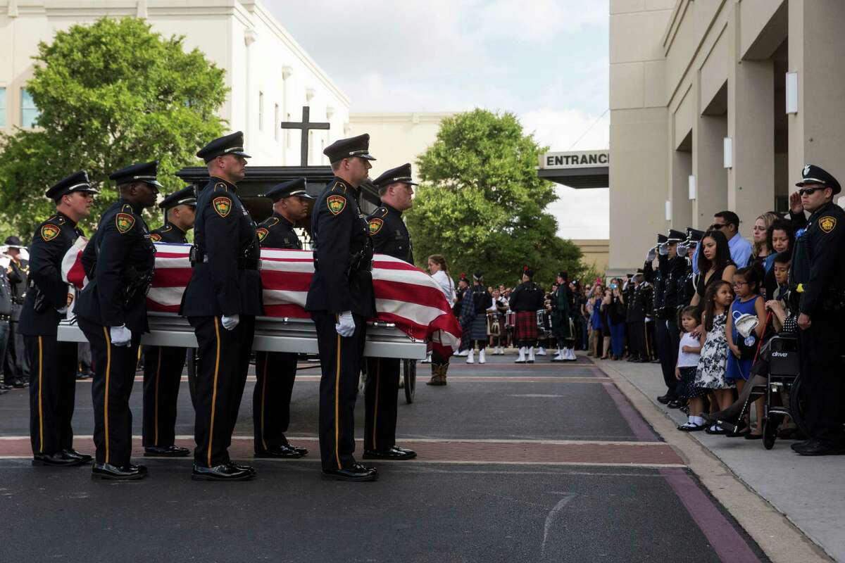 The San Antonio Police Department's Honor Guard carry the casket by the family during the funeral for Officer Miguel Moreno III, who was killed in the line of duty, at the Community Bible Church in San Antonio, Texas on July 7, 2017.