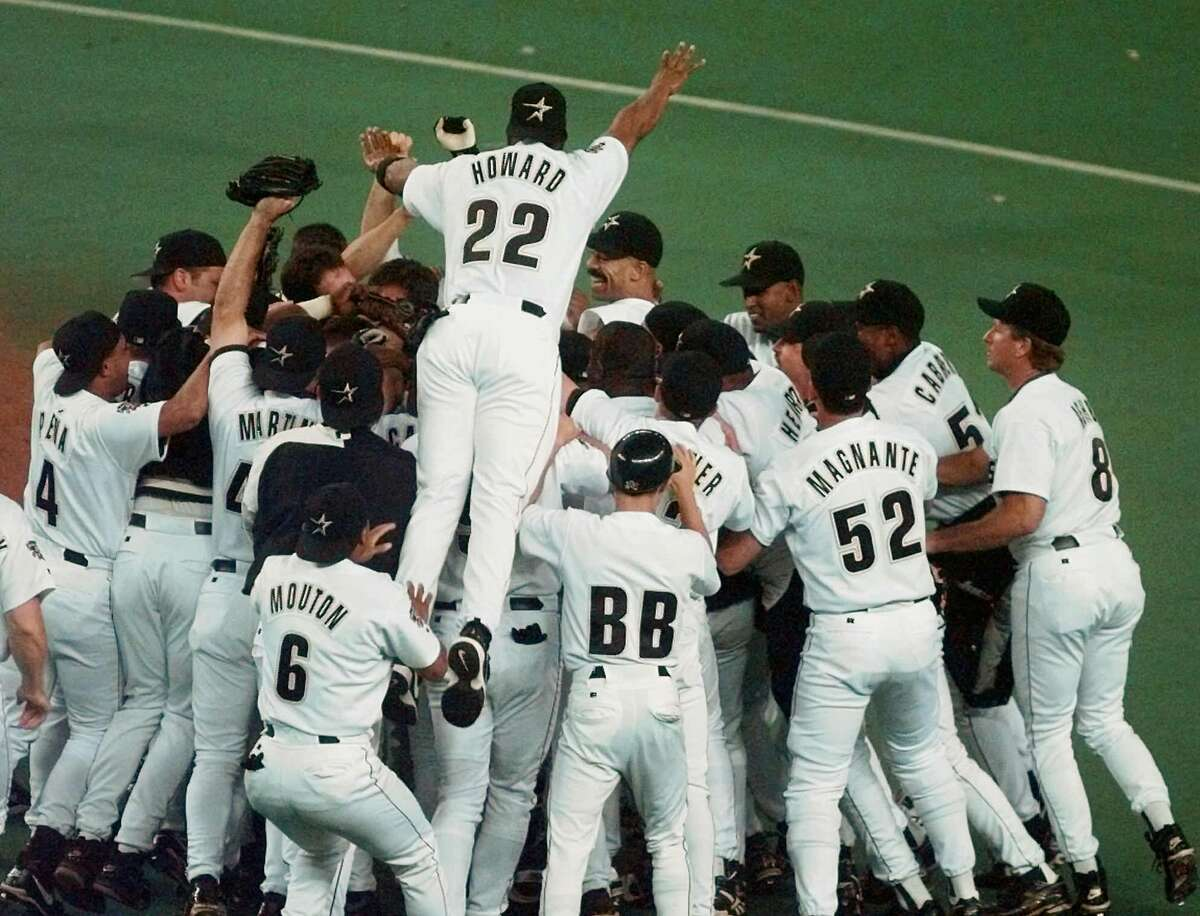PHOTOS: What did Houston look like in 1997? The Houston Astros' Thomas Howard jumps onto the pile of celebrating players as the Astros beat the Chicago Cubs 9-1 to clinch the National League Central Division Championship Thursday, Sept. 25, 1997 in Houston. Click through to see more images from Houston 20 years ago...