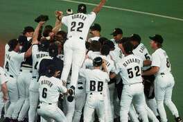 The Houston Astros' Thomas Howard jumps onto the pile of celebrating players as the Astros beat the Chicago Cubs 9-1 to clinch the National League Central Division Championship Thursday, SDept. 25, 1997 in Houston. (AP Photo/Pat Sullivan)