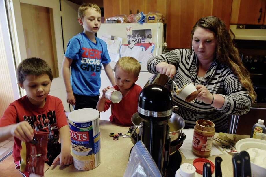 Amy Tilt and her sons, from left to right, Alexander, 5, Xavier, 9, and Terrence, Jr., 2, mix up cookie dough in the kitchen at the Haven of Hope Farm  on Tuesday, June 27, 2017, in Fonda, N.Y.  The women who live on the farm make and sell baked goods to help support the farm.   (Paul Buckowski / Times Union) Photo: PAUL BUCKOWSKI / 20040891A