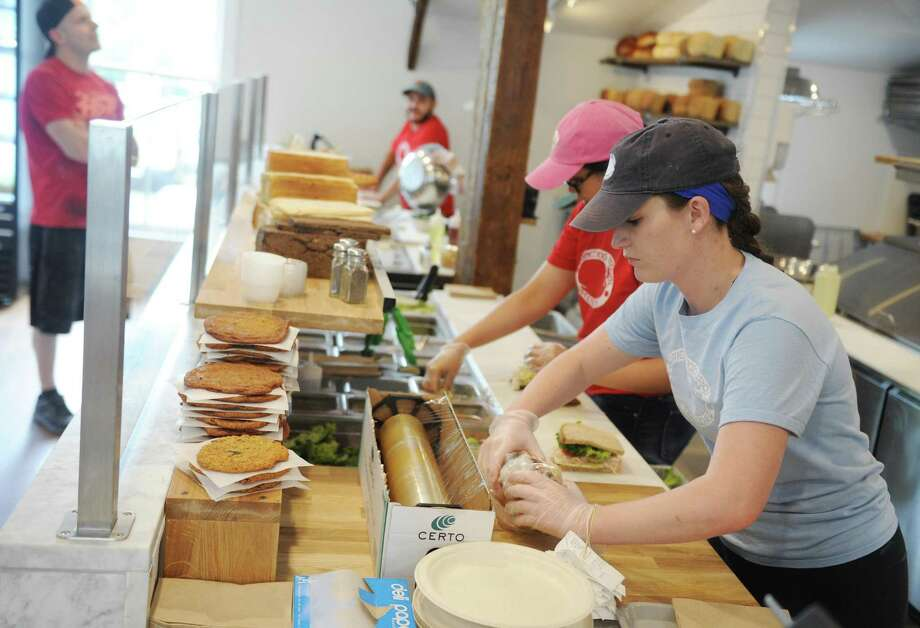 Ruby Fee wraps a sandwich at the new sandwich and salad shop Something Natural in Greenwich, Conn. Thursday, July 6, 2017. The Nantucket-based eatery recently opened up its Greenwich location at 189 Greenwich Ave., behind Saks Fifth Avenue. Photo: Tyler Sizemore / Hearst Connecticut Media / Greenwich Time