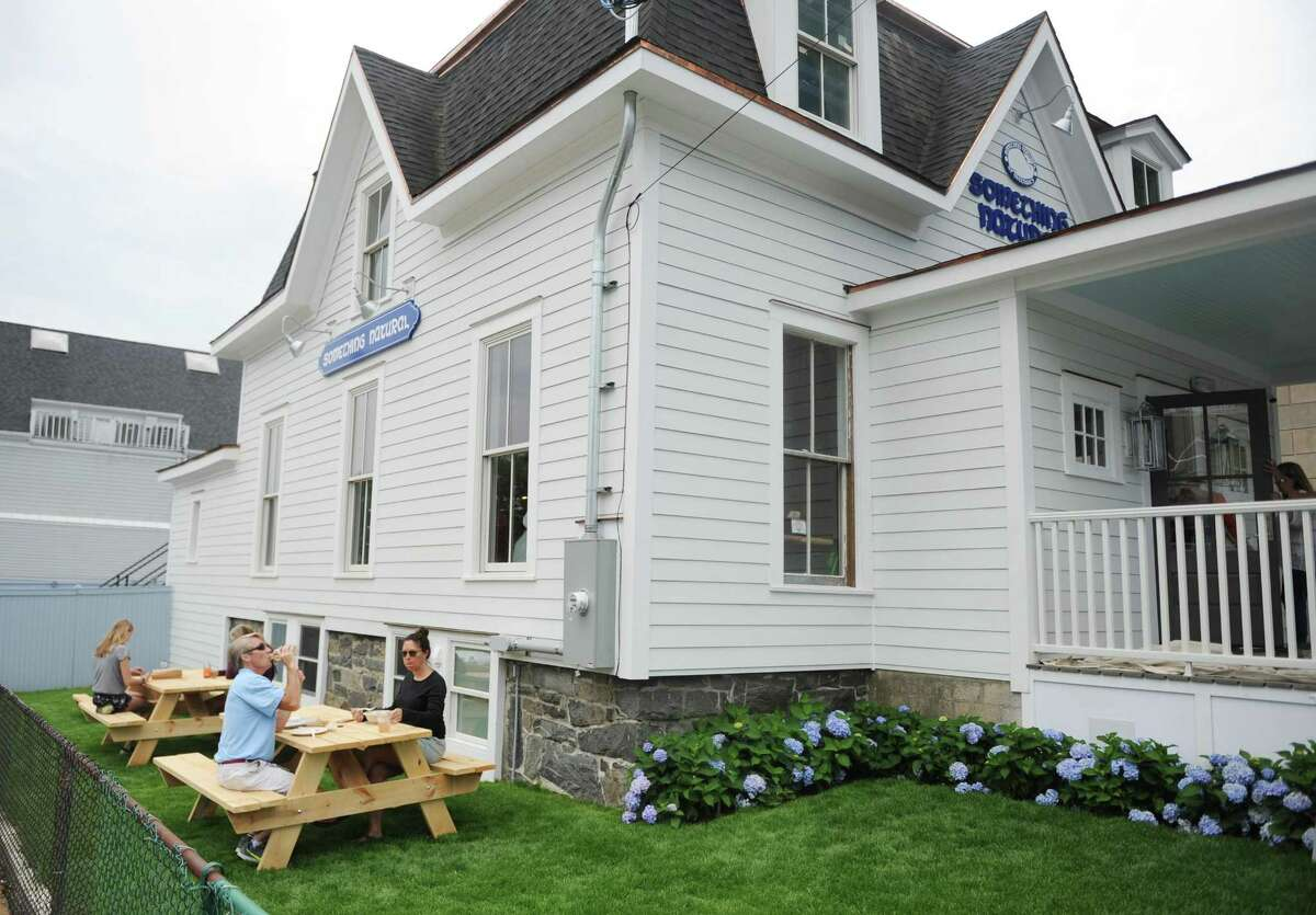 Customers eat outside at the new sandwich and salad shop Something Natural in Greenwich, Conn. Thursday, July 6, 2017. The Nantucket-based eatery recently opened up its Greenwich location at 189 Greenwich Ave., behind Saks Fifth Avenue.