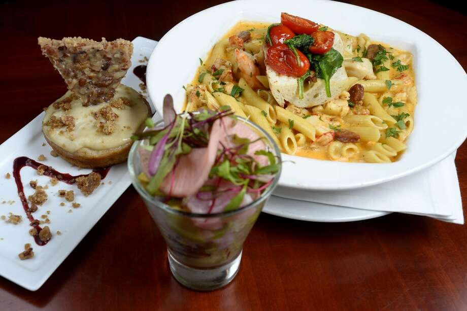 Bananas foster coffee cake, seafood pasta and tuna ceviche from Suga's Deep South Cuisine and Jazz Bar.  Photo taken Thursday 6/29/17 Ryan Pelham/The Enterprise Photo: Ryan Pelham/The Enterprise