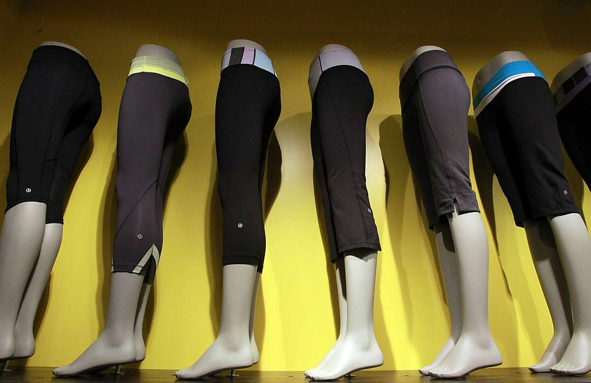 FILE -- A line of yoga pants is displayed at Lululemon at a store at the South Coast Plaza in Costa Mesa as seen June 19, 2011. Close to 150 of the pricy yoga pants were taken from a Fresno Lululemon store and could be tied to a number other Lululemon store thefts in the area.