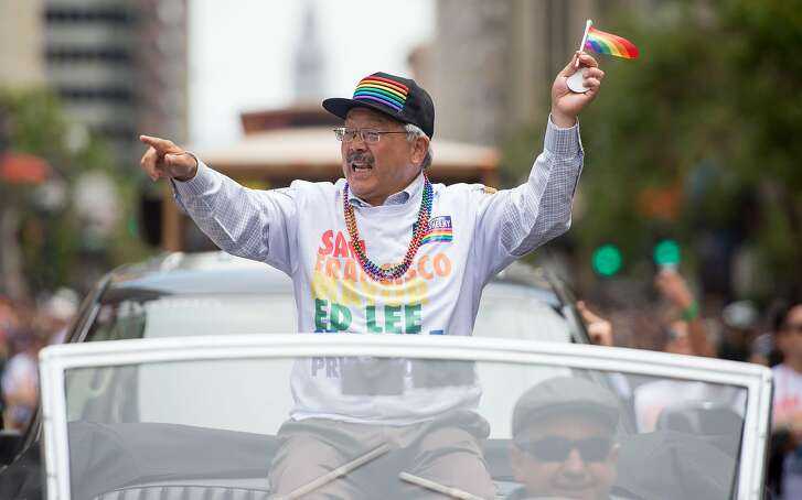 San Francisco Mayor Ed Lee waves to a cheering crowd along the San Francisco Pride  Parade route in San Francisco, California on Sunday, June, 25, 2017. / AFP PHOTO / Josh EdelsonJOSH EDELSON/AFP/Getty Images