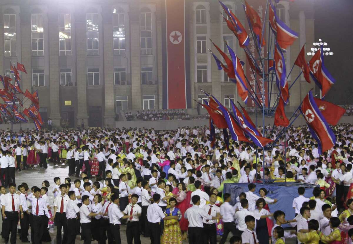 People gather in Kim Il Sung Square in Pyongyang, North Korea, Thursday to celebrate the test launch of North Korea's first intercontinental ballistic missile two days earlier. The North's ICBM launch, its most successful missile test to date, has stoked security worries in Washington, Seoul and Tokyo.