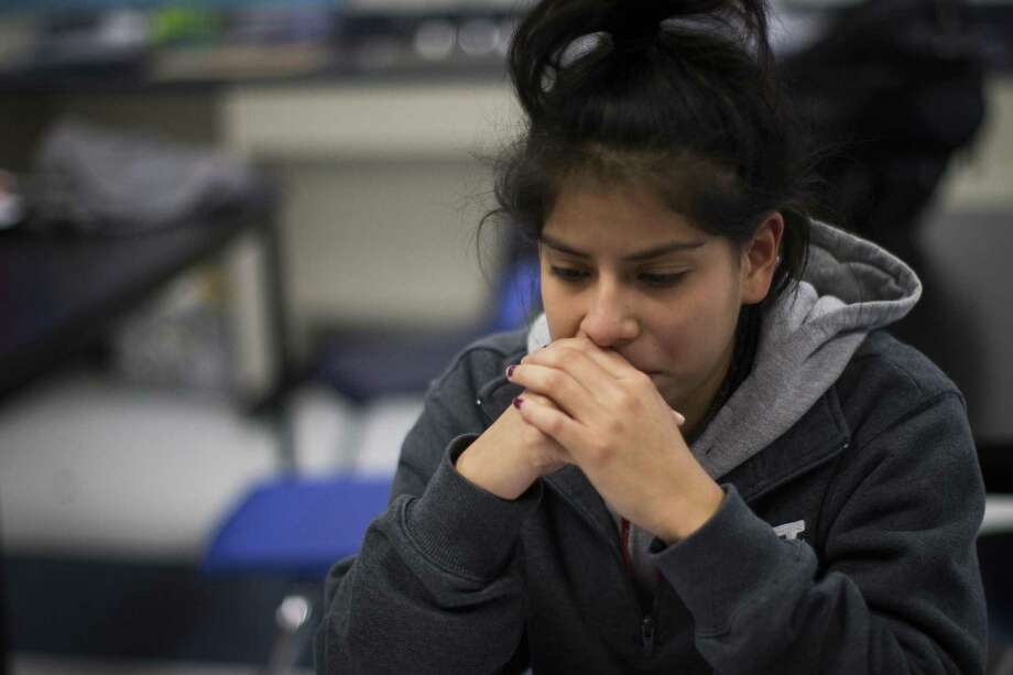 """Monica Alfaro, a YesPrep Gulfton student, gets emotional as she shares with other """"dreamer"""" club members the pain she feels in January thinking that the Deferred Action for Childhood Arrivals program would get repealed by President Donald Trump. Since then, Trump has reconsidered but several states, including Texas, are threatening to sue if the federal government doesn't scrap the program. Photo: Marie D. De Jesús /Houston Chronicle / © 2017 Houston Chronicle"""