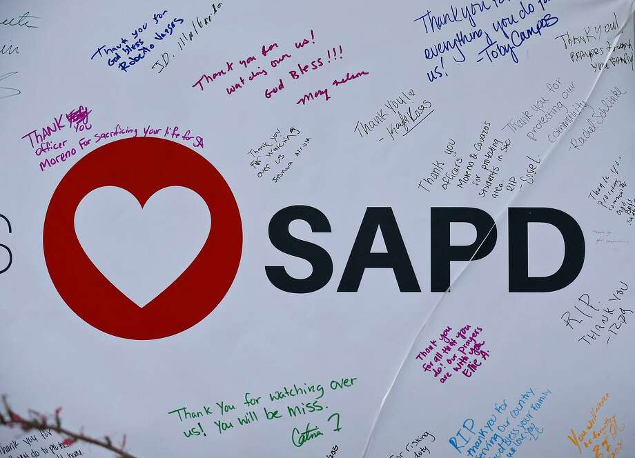 Detail of a banner at a memorial for SAPD Officer Miguel Moreno, 32. Moreno was one of two officers shot in the 200 block of W. Evergreen St. near San Antonio College on June 29. Moreno died the next day. Photo: Edward A. Ornelas /San Antonio Express-News / © 2017 San Antonio Express-News