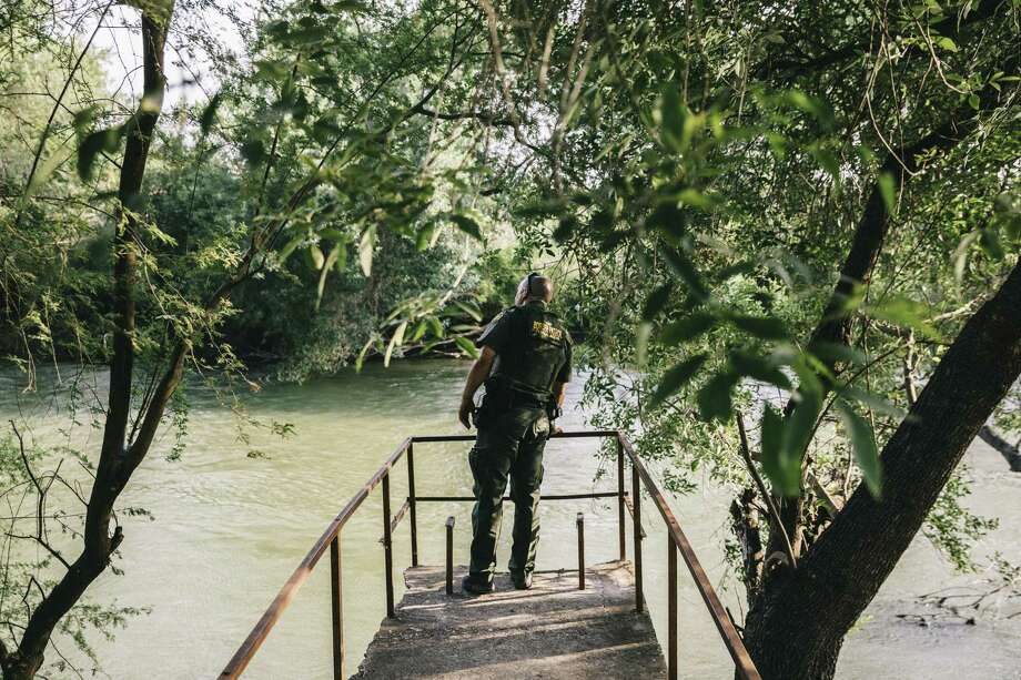 A Border Patrol agent surveys the Rio Grande from a dock near Roma. Donald Trump's election victory has sparked a call in Democratic circles for the party to rethink its position on immigration — a sign that, economic issues aside, there is core dissatisfaction with the nation's policies. Photo: William Widmer /New York Times / NYTNS