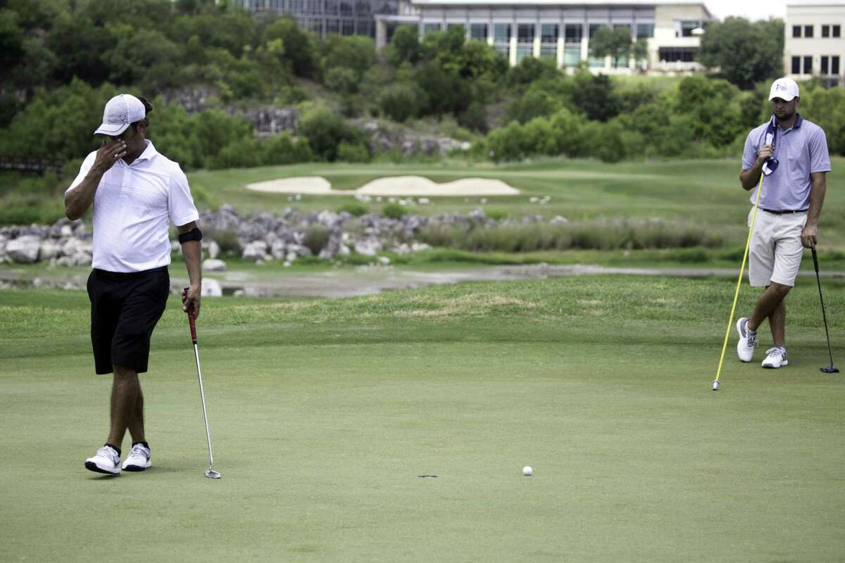 Chadwick Jones, left, is in disbelief after missing a putt as Redmond Lyons looks on. The Greater San Antonio Men's Championship kicked off round 1, Saturday, July 7, 2017, at the Quarry Golf Club.