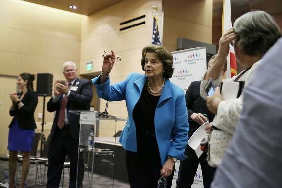 Sen. Dianne Feinstein, D-Calif., waves after speaking at a news conference about health care at the UCSF Benioff Children's Hospital Friday, July 7, 2017, in San Francisco. Feinstein addressed how Medicaid cuts in the Senate Republican health care bill would devastate care for children. (AP Photo/Eric Risberg)