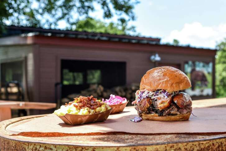 Truth BBQ pitmaster Leonard Botello IV mans the fire at the Brenham location. Truth has announced it will open a second location in Houston to serve its sandwiches, sides and more.