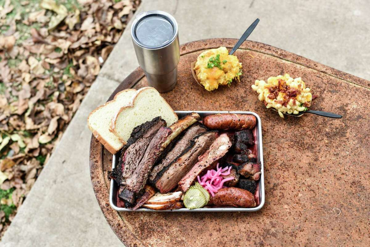 A barbecue spread with sides at Truth BBQ in Brenham