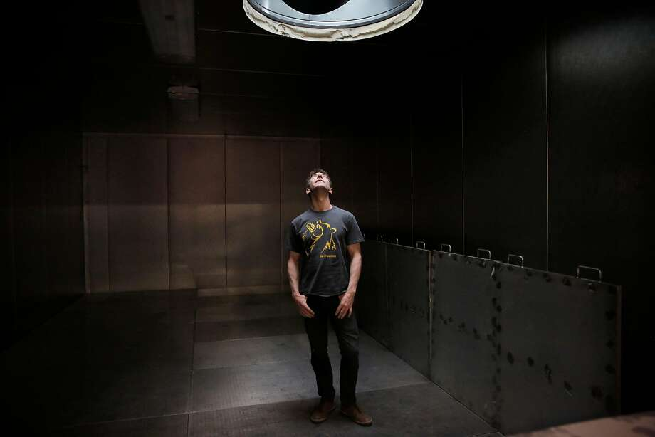 Ron Silberstein, Admiral Maltings co-founder, looks up as he stands in the kiln at Admiral Maltings. Photo: Lea Suzuki, The Chronicle