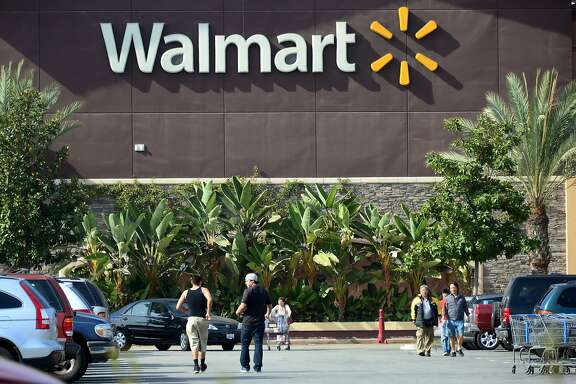 (FILES) This January 29, 2014 file photo shows shoppers outside a Walmart store in Rosemead, California. US retail king Wal-Mart announced October 7, 2104 that it is eliminating health benefits to some 30,000 employees to control rising healthcare costs. The cuts would apply to those employees working fewer than 30 hours per week.  AFP PHOTO / FREDERIC J. BROWN / FILESFREDERIC J. BROWN/AFP/Getty Images
