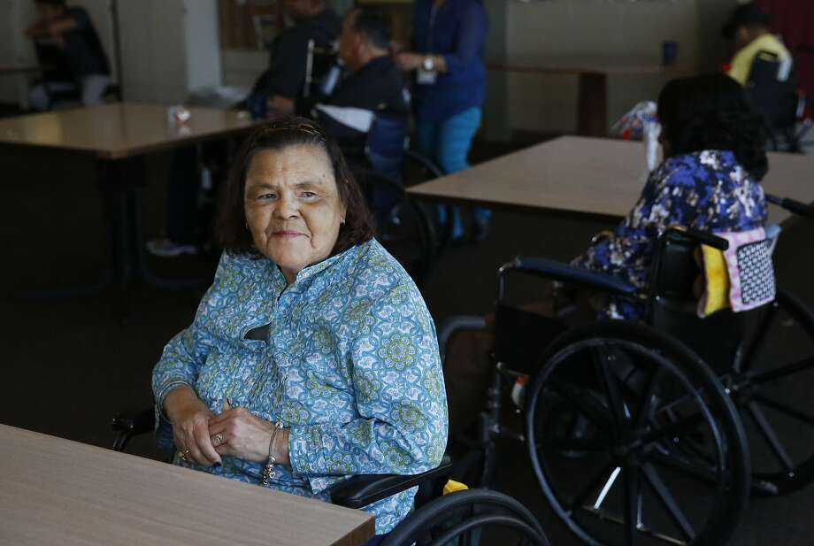 Catherine Araujo, 65, waits for live music in the community room at the Waters Edge skilled nursing facility July 7, 2017 in Alameda, Calif. Photo: Leah Millis, The Chronicle