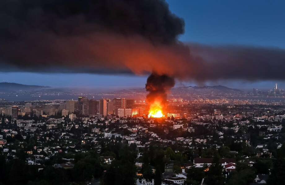 A massive fire at a downtown Oakland construction site as seen from the Oakland Hills on July 7, 2017 at approximately 5:25 am PST. Photo: Jonathan Goody, Special To The Chronicle