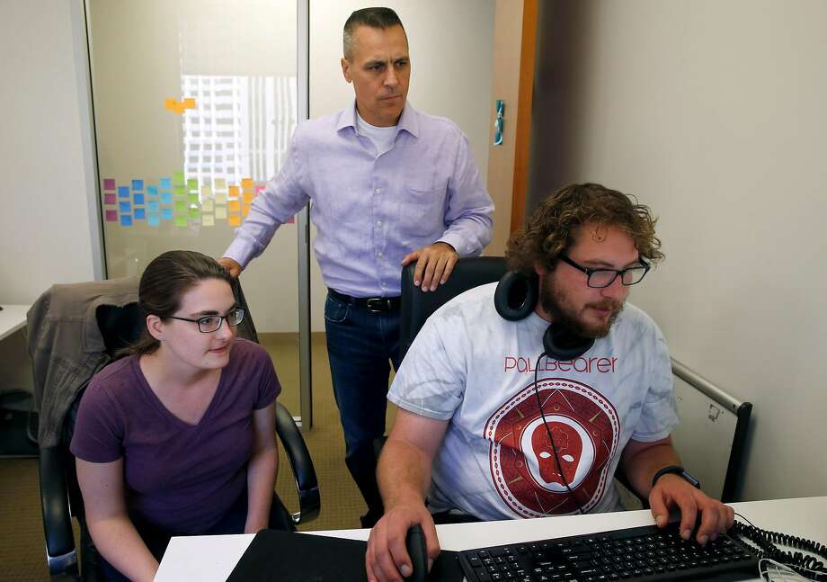 Mark Weidick (center), CEO of data analytics startup HiQ Labs, works with Liz Brokken and Cameron Cole in S.F. Photo: Paul Chinn, The Chronicle