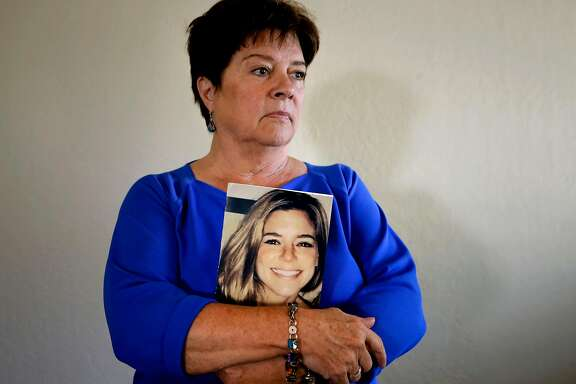 Liz Sullivan at her home in Livermore, Calif., the mother of Kate Steinle  holds a photo of her daughter who was shot and killed on Pier 14 in July, in San Francisco, Calif.
