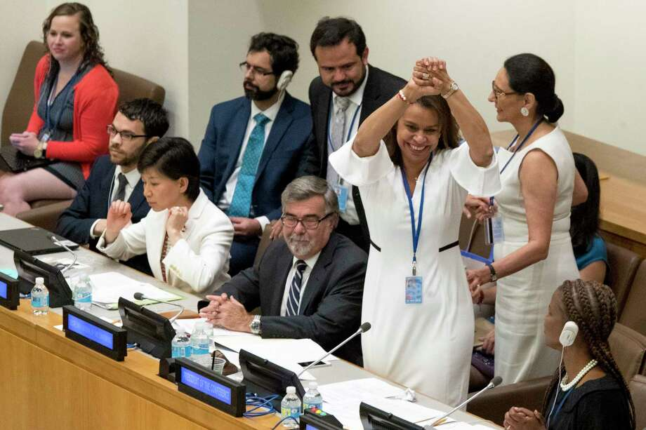 Costa Rican Ambassador Elayne Whyte Gomez, President of the United Nations Conference to Negotiate a Legally Binding Instrument to Prohibit Nuclear Weapons, reacts after a vote by the conference to adopt a legally binding instrument to prohibit nuclear weapons, leading towards their total elimination, Friday, July 7, 2017 at United Nations headquarters. More than 120 countries have approved the first-ever treaty banning nuclear weapons at a U.N. meeting boycotted by all nuclear-armed nations. Friday's vote was 122 countries in favor with the Netherlands opposed and Singapore abstaining.(AP Photo/Mary Altaffer) Photo: Mary Altaffer, STF / Copyright 2017 The Associated Press. All rights reserved.