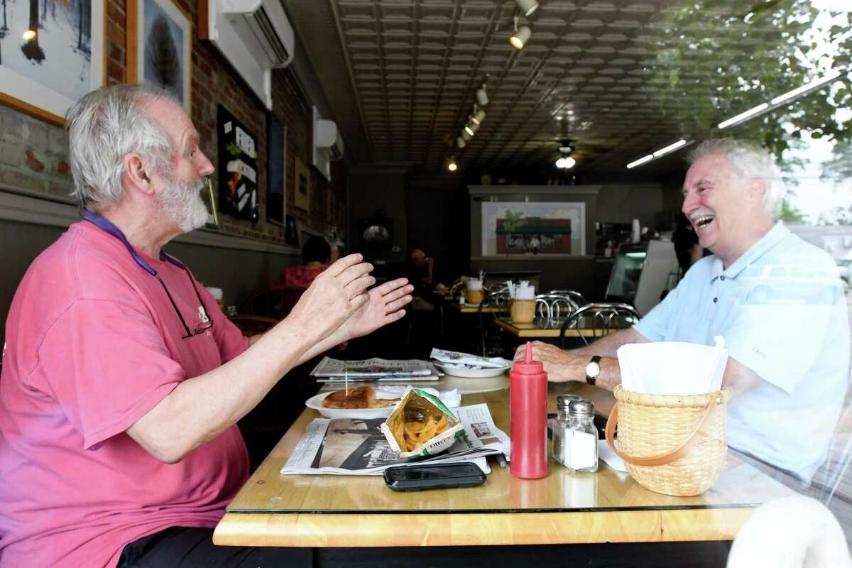 While lunching at Woods End, Pat Speer and Tom Lattin, both of Bridgeport, share a laugh.