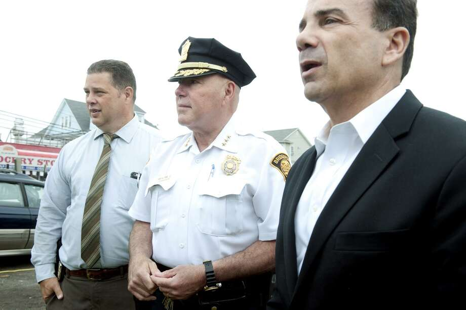 """From left, Police Union President Chuck Paris, Police Chief Armando """"A.J."""" Perez and Mayor Joe Ganim attend a press conference at the Charles F. Greene Homes in Bridgeport, Conn. June 16, 2017. Photo: Ned Gerard / Hearst Connecticut Media / Connecticut Post"""