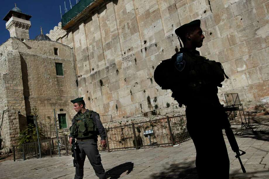 Both Jews and Muslims revere the same site in Hebron as the traditional burial place of the biblical patriarchs. The Jews call it the Tomb of the Patriarchs, while the Muslims refer to it as the Ibrahimi Mosque. Photo: Bernat Armangue, STF / Copyright 2017 The Associated Press. All rights reserved.