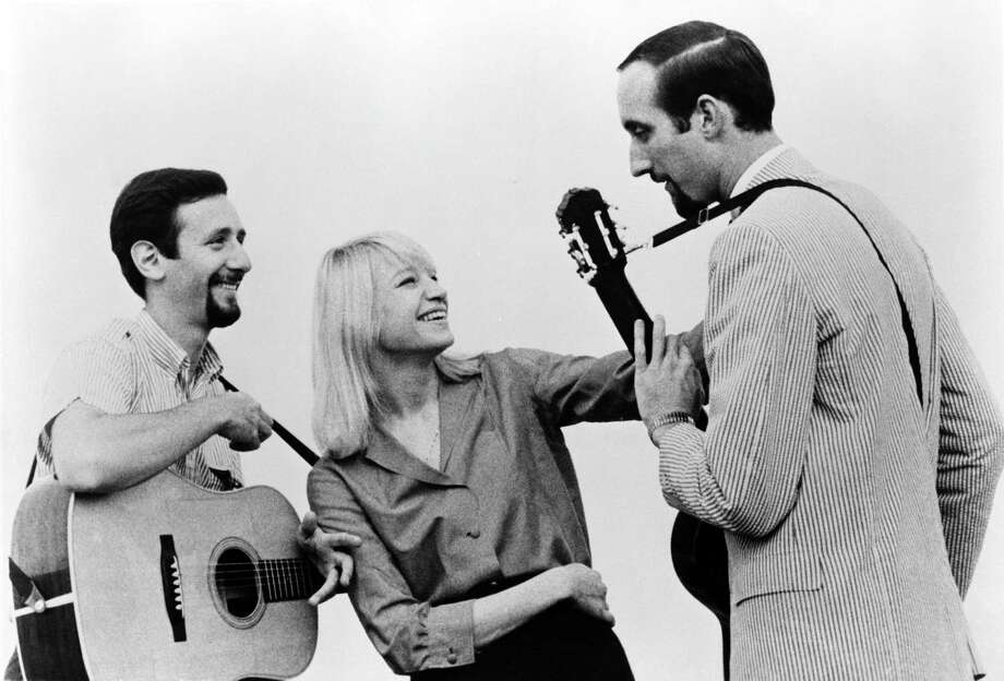 Peter Yarrow, left, Mary Travers and Paul Stookey of the folk group Peter, Paul & Mary pose for a portrait circa 1965. Stookey and Yarrow tour as a duo since Travers died in 2009. Photo: Michael Ochs Archives / Getty Images / This content is subject to copyright.