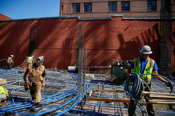 Construction workers at the site for a seven story condominium at 288 Pacifica developed by Grosvenor Americas Inc in the Jackson Square neighborhood of San Francisco on Wednesday, June 21, 2017.