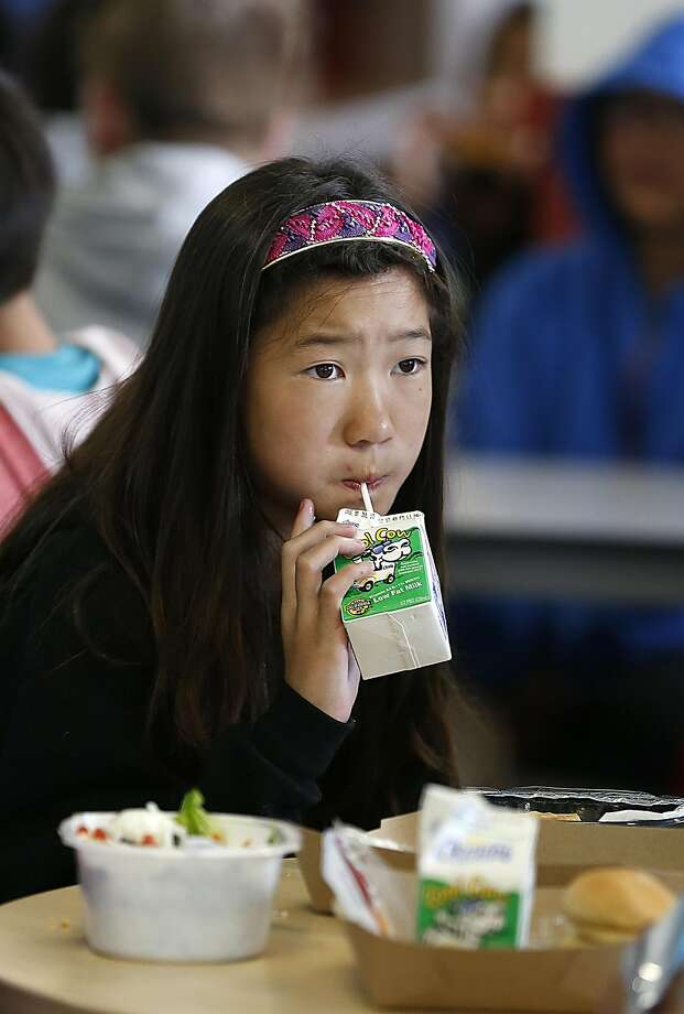 Mikayla Huey, 10 years old,  in sixth grade comments unfavorably to no chocolate milk during school lunch as she has lunch with other  summer school students at Washington High School on Thursday, July 6, 2017, in San Francisco, Calif.   San Francisco Unified school has decided to ban chocolate milk during lunch starting this fall. Photo: Liz Hafalia, The Chronicle